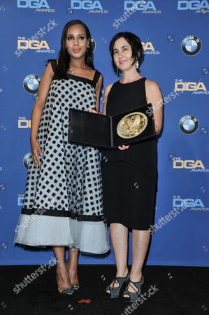 Kerry Washington, left, and Amy Schatz pose in the press room of the the 66th Annual DGA Awards Dinner at the Hyatt Regency Century Plaza Hotel, in Los Angeles, Calif