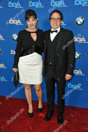 Janet Grillo, left, and David O. Russell arrive at 66th Annual DGA Awards Dinner at the Hyatt Regency Century Plaza Hotel, in Los Angeles, Calif