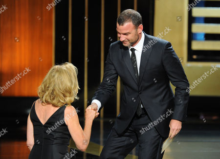 Stock Image of Live Schreiber, right, presents Jessica Lange with the award for outstanding lead actress in a miniseries or a movie on stage at the 66th Primetime Emmy Awards at the Nokia Theatre L.A. Live, in Los Angeles