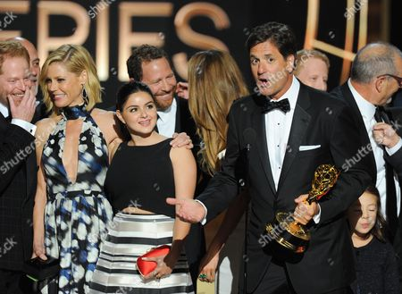 """Steven Levitan, center, and the cast and producers of """"Modern Family"""" accept the award for outstanding comedy series at the 66th Primetime Emmy Awards at the Nokia Theatre L.A. Live, in Los Angeles"""