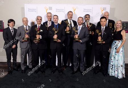 Michael Cronk, winner of the Philo T. Farnsworth award for Grass Valley USA, second left, Garrett Brown, winner of the Charles F. Jenkins lifetime achievement award, second right, and from third left, Engineering Emmy award winners Chris King of SpeedTree, Mark Franken of EdiCue, Greg Croft of SpeedTree, Alan Bovik of SSIM, Michael Sechrest of SpeedTree, Hamid Sheikh and Zhou Wang of SSIM, pose for a portrait with Josh Brener, left, and Wendy Aylsworth, Engineering Emmy Awards committee chair, right, at the 67th Engineering Emmy Awards at the Loews Hollywood Hotel, in Los Angeles