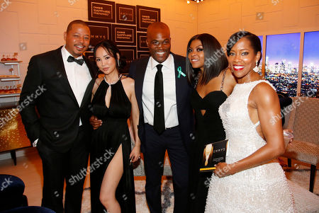 Terrence Howard, from left, Miranda Howard, Chris Spencer, Taraji P. Henson, and Regina King pose in the Chase Sapphire Preferred Blue Room at the 67th Primetime Emmy Awards, at the Microsoft Theater in Los Angeles