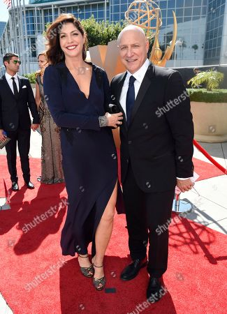 Lori Silverbush, left, and Tom Colicchio arrive at the 67th Primetime Emmy Awards, at the Microsoft Theater in Los Angeles