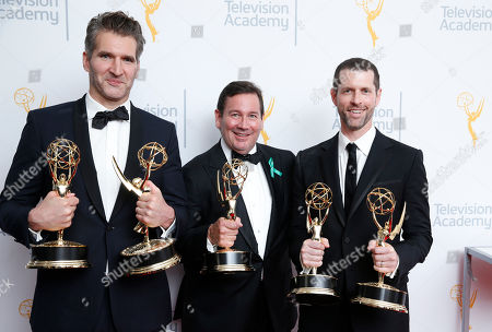 """David Benioff, left, and D.B. Weiss, right, winners of the outstanding writing for a drama series for """"Game Of Thrones"""" and David Nutter, winner of the award for outstanding director for """"Game Of Thrones,"""" pose at the 67th Primetime Emmy Awards, at the Microsoft Theater in Los Angeles"""