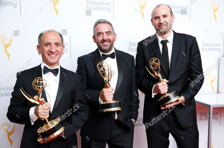 Veep writers, Armando Iannucci, from left, Simon Blackwell and Tony Roche at the 67th Primetime Emmy Awards, at the Microsoft Theater in Los Angeles