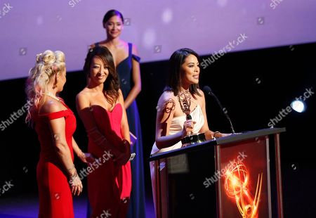 Kimberly Cornell, from left, Angel C. Kim, and Cher Calvin from KTLA5 accept the Emmy for LA Local Color for Stan Chambers: Legendary Newsman at the L.A. Area Emmy Awards presented at the Television Academy's new Saban Media Center, in the NoHo Arts District in Los Angeles