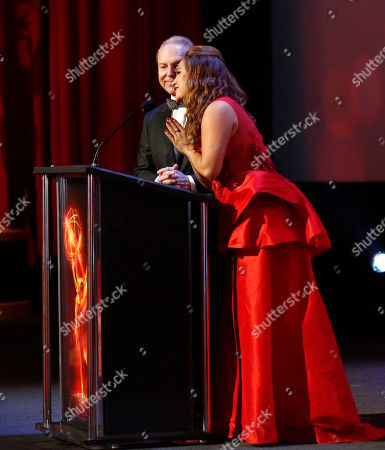 Rick Reiff, left, and Elizabeth Espinosa present the Emmy for Sports Special at the L.A. Area Emmy Awards presented at the Television Academy's new Saban Media Center, in the NoHo Arts District in Los Angeles