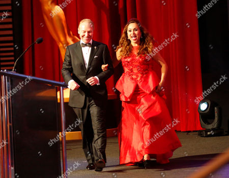 Stock Picture of Rick Reiff, left, and Elizabeth Espinosa present the Emmy for Sports Special at the L.A. Area Emmy Awards presented at the Television Academy's new Saban Media Center, in the NoHo Arts District in Los Angeles