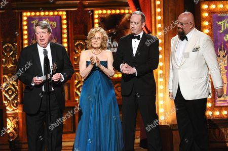 Andre Bishop, left, and crew accept the award for best revival of a musical for The King and I at the 69th annual Tony Awards at Radio City Music Hall, in New York