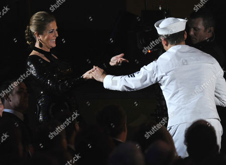 Tony Yazbeck, right, dances with Rita Wilson in the audience during a number from â?oeOn the Townâ?? at the 69th annual Tony Awards at Radio City Music Hall, in New York