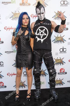 Alissa White-Gluz of Arch Enemy, left, and Doyle Wolfgang von Frankenstein of The Misfits attend the 6th Annual Revolver Golden Gods Award Show at Club Nokia on in Los Angeles, California