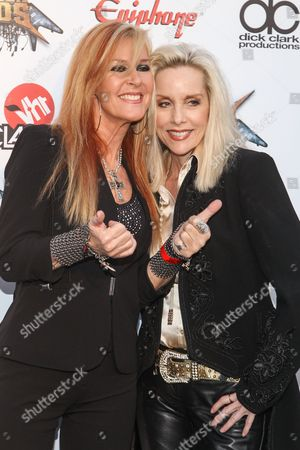 MusiciansLita Ford, left and Cherie Currie attend the 6th Annual Revolver Golden Gods Award Show at Club Nokia on in Los Angeles, California