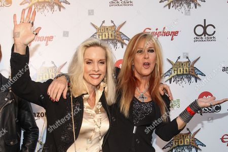 Musicians Cherie Currie, left and Lita Ford attend the 6th Annual Revolver Golden Gods Award Show at Club Nokia on in Los Angeles, California