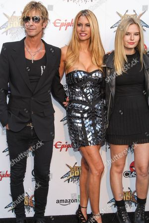 Bassist Duff McKagan of Guns N' Roses, wife Susan Holmes, and daughter Grace McKagan attend the 6th Annual Revolver Golden Gods Award Show at Club Nokia on in Los Angeles, California