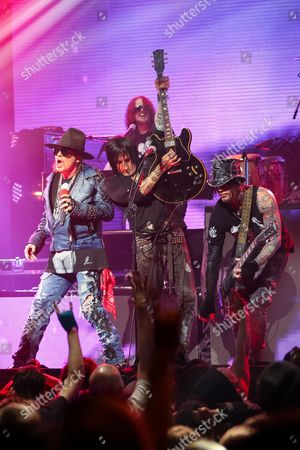 From left, Axl Rose, Richard Fortus, and DJ Ashba of Guns N' Roses perform on stage at the 6th Annual Revolver Golden Gods Award Show at Club Nokia on in Los Angeles, California