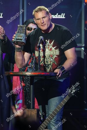 Stock Photo of MMA Fighter Josh Barnett receives the Most Metal Athlete award on stage at the 6th Annual Revolver Golden Gods Award Show at Club Nokia on in Los Angeles, California