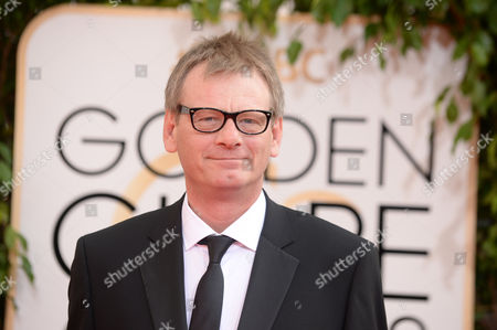 Hollywood Foreign Press Association president Theo Kingma arrives at the 71st annual Golden Globe Awards at the Beverly Hilton Hotel, in Beverly Hills, Calif