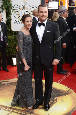 Stock Image of Caroline Fentress, left, and Chris O'Donnell arrive at the 71st annual Golden Globe Awards at the Beverly Hilton Hotel, in Beverly Hills, Calif