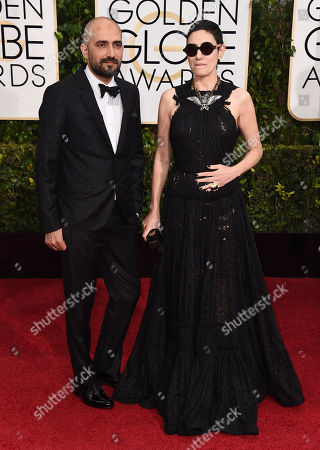 Stock Picture of Shlomi Elkabetz, left, and Ronit Elkabetz arrive at the 72nd annual Golden Globe Awards at the Beverly Hilton Hotel, in Beverly Hills, Calif