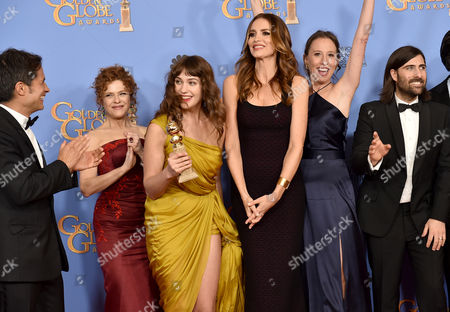 Gael Garcia Bernal, from left, Bernadette Peters, Lola Kirke, Saffron Burrows, Caroline Baron, and Jason Schwartzman pose in the press room with the award for best television series - musical or comedy for Mozart in the Jungle at the 73rd annual Golden Globe Awards, at the Beverly Hilton Hotel in Beverly Hills, Calif
