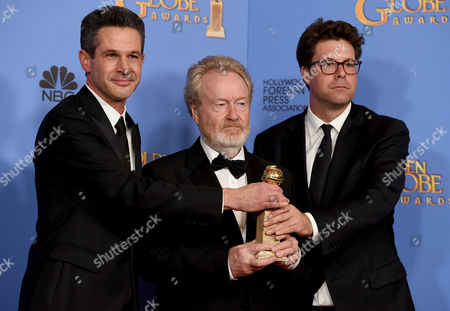 Stock Image of Simon Kinberg, from left, Ridley Scott, and Michael Schaefer pose in the press room with the award for best motion picture - musical or comedy for The Martian at the 73rd annual Golden Globe Awards, at the Beverly Hilton Hotel in Beverly Hills, Calif