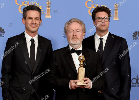 Simon Kinberg, from left, Ridley Scott, and Michael Schaefer pose in the press room with the award for best motion picture - musical or comedy for The Martian at the 73rd annual Golden Globe Awards, at the Beverly Hilton Hotel in Beverly Hills, Calif