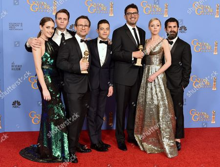 Carly Chaikin, from left, Martin Wallstrom, Christian Slater, Rami Malek, Sam Esmail, Portia Doubleday, and Chad Hamilton poses in the press room with the award for best TV series - drama for Mr. Robot at the 73rd annual Golden Globe Awards, at the Beverly Hilton Hotel in Beverly Hills, Calif