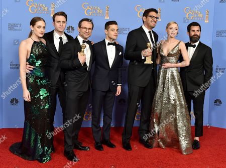 Carly Chaikin, from left, Martin Wallstrom, Christian Slater, Rami Malek, Sam Esmail, Portia Doubleday, and Chad Hamilton poses in the press room with the award for best television series - drama for Mr. Robot at the 73rd annual Golden Globe Awards, at the Beverly Hilton Hotel in Beverly Hills, Calif