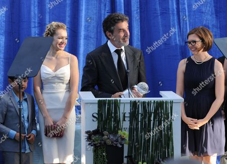 """Chuck Lorre, center, and from left, Blake Garrett Rosenthal, Sadie Calvano and Gemma Bakerthe accept a Television Academy Honors award for """"Mom"""" at the 7th annual Television Academy Honors presented by the Television Academy at the SLS Hotel, in Beverly Hills, Calif"""