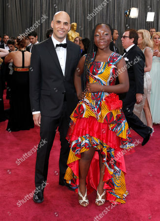 Director Kim Nguyen, left, and actress Rachel Mwanza arrive at the 85th Academy Awards at the Dolby Theatre, in Los Angeles