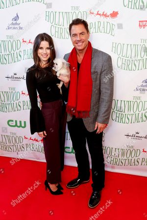 Julie Freyermuth, left, and Mark Steines arrive at the 85th Annual Hollywood Christmas Parade, in Los Angeles