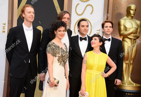 From left, Richard Reed Parry, Rgine Chassagne, Win Butler, William Butler, Sarah Neufeld and Owen Pallett of Arcade Fire arrive at the Oscars, at the Dolby Theatre in Los Angeles