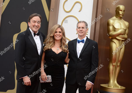 From left, Peter Del Vecho, Jennifer Lee and Chris Buck arrive at the Oscars, at the Dolby Theatre in Los Angeles