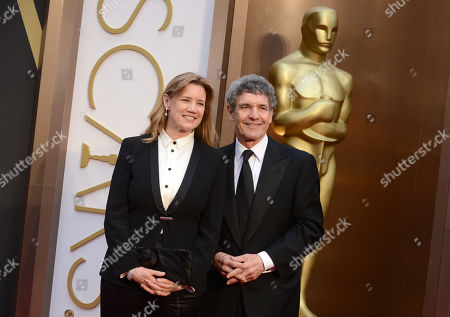 Alan F. Horn, right, and wife Cindy Horn arrive at the Oscars, at the Dolby Theatre in Los Angeles