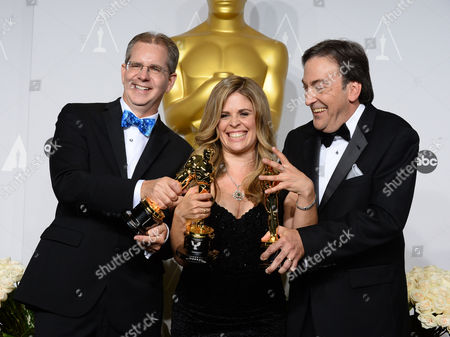 "Chris Buck, from left, Jennifer Lee and Peter Del Vecho pose in the press room with the award for Best animated feature film of the year for ""Frozen"" during the Oscars at the Dolby Theatre, in Los Angeles"