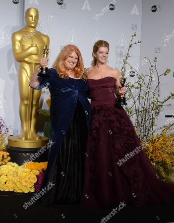 "Adruitha Lee, left, and Robin Mathews accept the award for best makeup and hairstyling for ""Dallas Buyers Club"" - xxx poses in the press room during the Oscars at the Dolby Theatre, in Los Angeles"