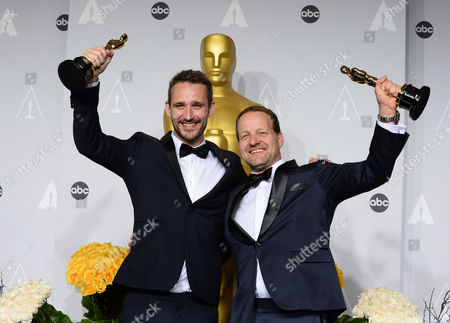 """Anders Walter, left, and Kim Magnusson pose in the press room with the award for best live action short film of the year for """"Helium"""" during the Oscars at the Dolby Theatre, in Los Angeles"""