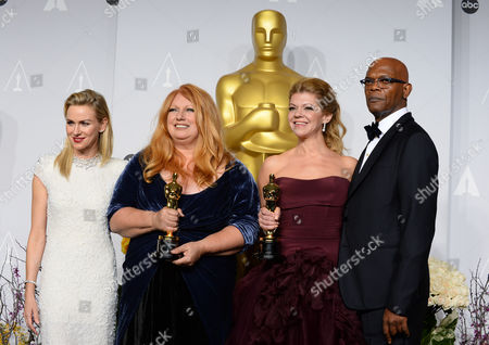 "Presenters Naomi Watts, left, and Samuel L. jackson, right, pose with Adruitha Lee, second left, and Robin Mathews, winners of the award for best makeup and hairstyling for ""Dallas Buyers Club"" in the press room during the Oscars at the Dolby Theatre, in Los Angeles"