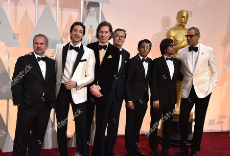 Jeremy Dawson, from left, Adrien Brody, Wes Anderson, Hugo Guinness, Tony Revolori, Jason Schwartzmann, and Jeff Goldblum arrives at the Oscars, at the Dolby Theatre in Los Angeles