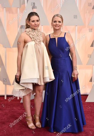 Cathleen Sutherland, right, and guest arrive at the Oscars, at the Dolby Theatre in Los Angeles