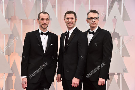 Anthony Stacchi, from left, Travis Knight, and Graham Annable arrive at the Oscars, at the Dolby Theatre in Los Angeles