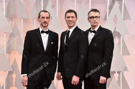 Anthony Stacchi, from left, Travis Knight and Graham Annable arrive at the Oscars, at the Dolby Theatre in Los Angeles