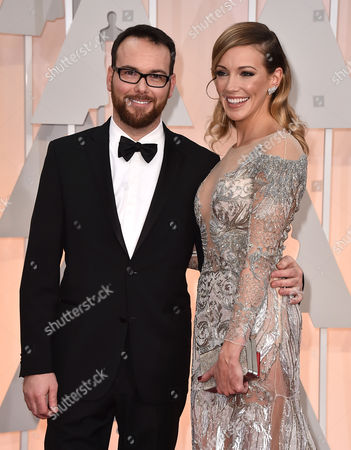 Dana Brunetti, left, and Katie Cassidy arrive at the Oscars, at the Dolby Theatre in Los Angeles