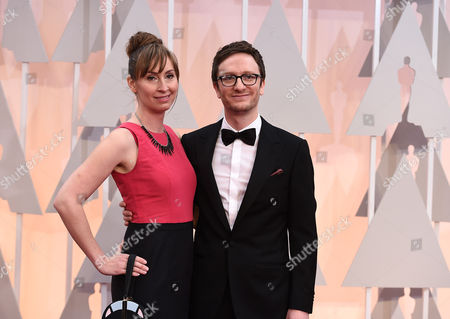 Liz Cackowski, left, and Akiva Schaffer arrive at the Oscars, at the Dolby Theatre in Los Angeles