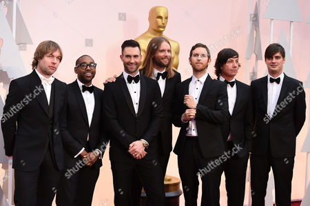 Mickey Madden, from left, PJ Morton, Adam Levine, James Valentine, Jesse Carmichael, Matt Flynn, and Sam Farrar of the musical group Maroon 5 arrive at the Oscars, at the Dolby Theatre in Los Angeles