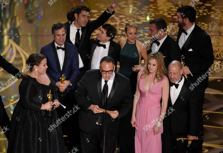 Nicole Rocklin, from left, Michael Sugar, Blye Pagon Faust, Steve Golin, and cast and crew of Spotlight accept the award for best picture for Spotlight at the Oscars, at the Dolby Theatre in Los Angeles