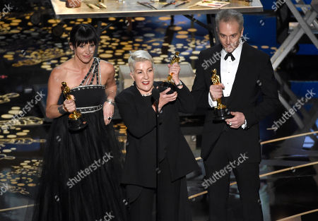 Elka Wardega, from left, Lesley Vanderwalt, and Damian Martin accept the award for best makeup and hairstyling for Mad Max: Fury Road at the Oscars, at the Dolby Theatre in Los Angeles
