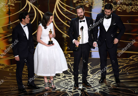 Shan Christopher Ogilvie, from left, Serena Armitage, Benjamin Cleary, and Michael Paleodimos accept the award for best live action short film for Stutterer at the Oscars, at the Dolby Theatre in Los Angeles