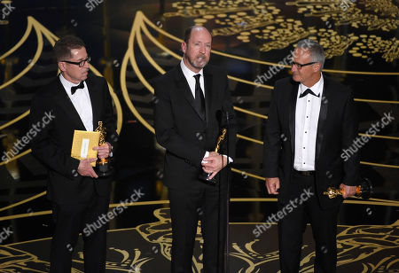 Gregg Rudloff, from left, Chris Jenkins, and Ben Osmo accept the award for best sound mixing for Mad Max: Fury Road at the Oscars, at the Dolby Theatre in Los Angeles