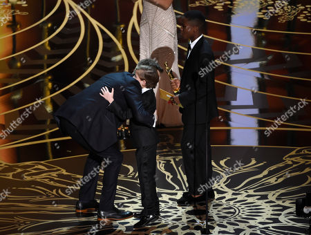 Jacob Tremblay, center, and Abraham Attah, right, present Benjamin Cleary with the award for best live action short film at the Oscars, at the Dolby Theatre in Los Angeles